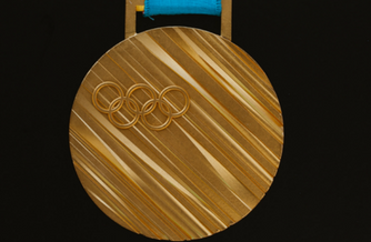 Olympics gold medal with the an embossed Olympics logo